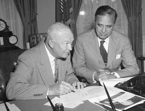 Original caption: Washington, D.C.: Senator Prescott Bush looks on as President Eisenhower approves his bill which provides for a survey of the East Coast of the U.S. to see what measures could be taken to prevent future hurricane damage. June 15, 1955 Washington, DC, USA